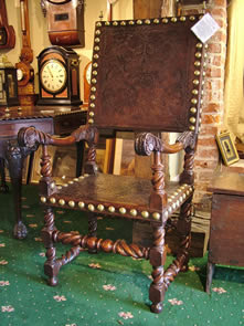 Studded walnut and leather clad throne chair